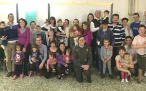 Don Livio Recluta con i genitori dei neo-battezzati nella parrocchia San Giuseppe Lavoratore a Torino